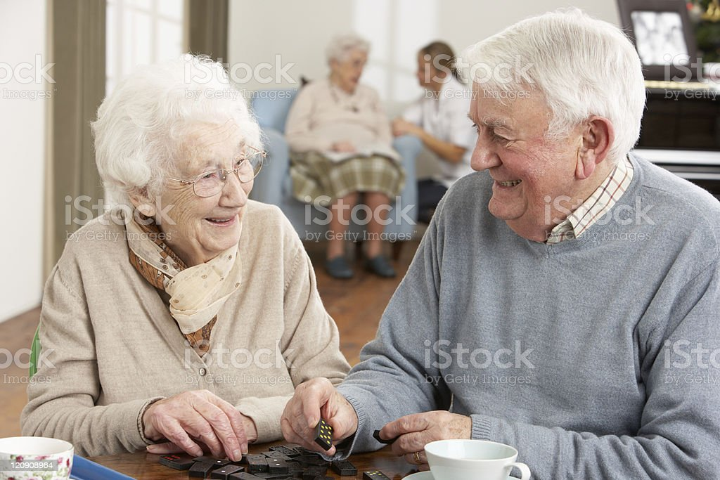 Couple Playing Dominoes At Day Care Centre royalty-free stock photo