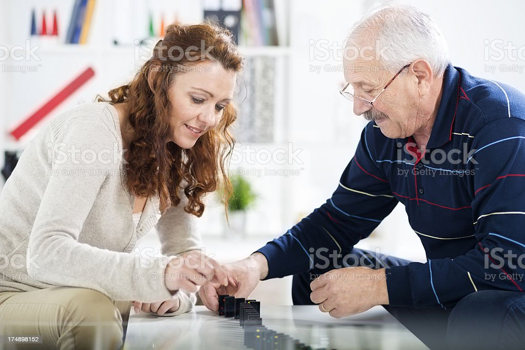 Couple playing dominos royalty-free stock photo
