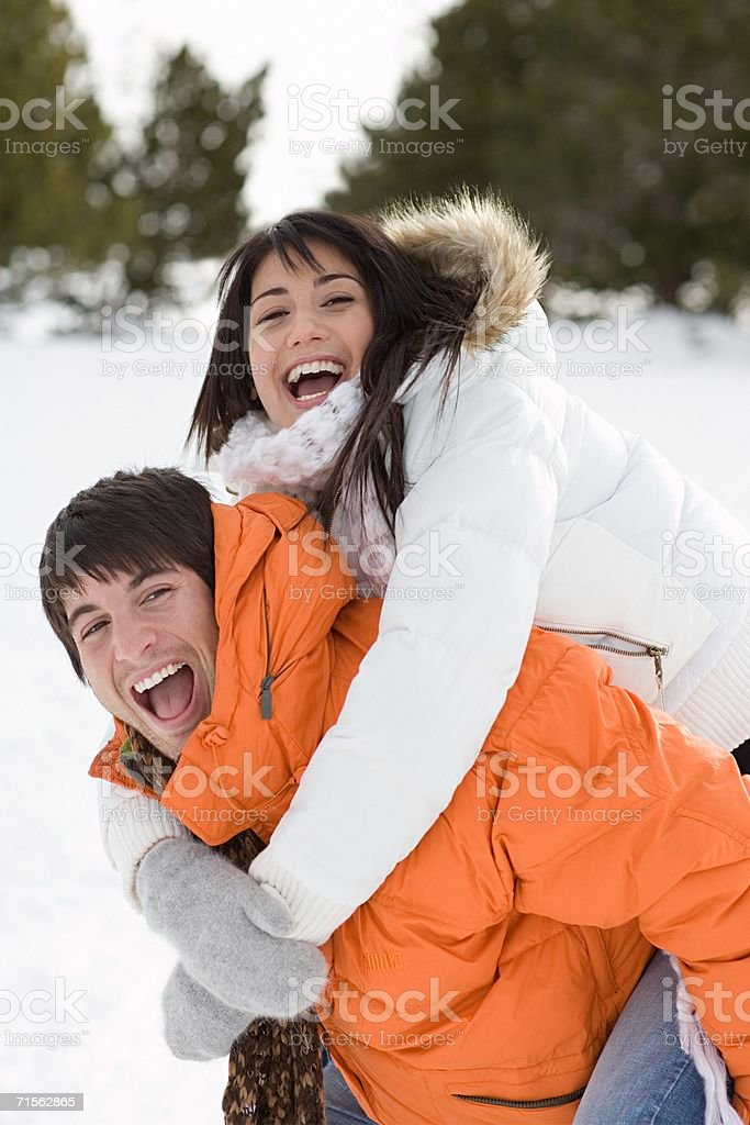 Couple playing in the snow royalty-free stock photo
