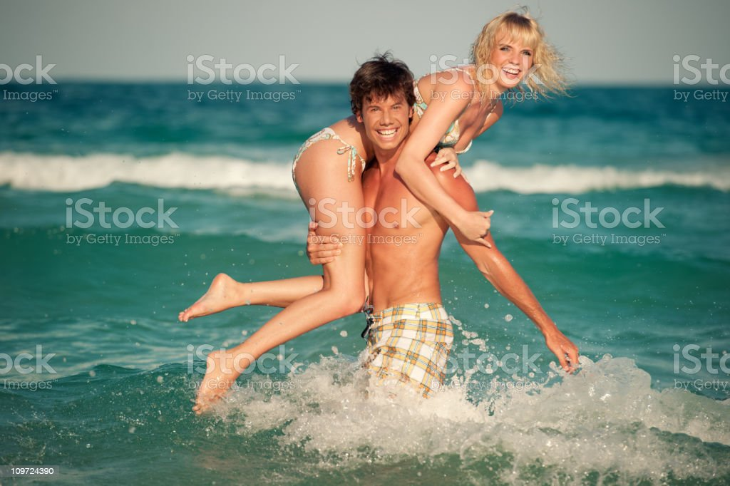 Couple playing in the Waves (XXXL) royalty-free stock photo