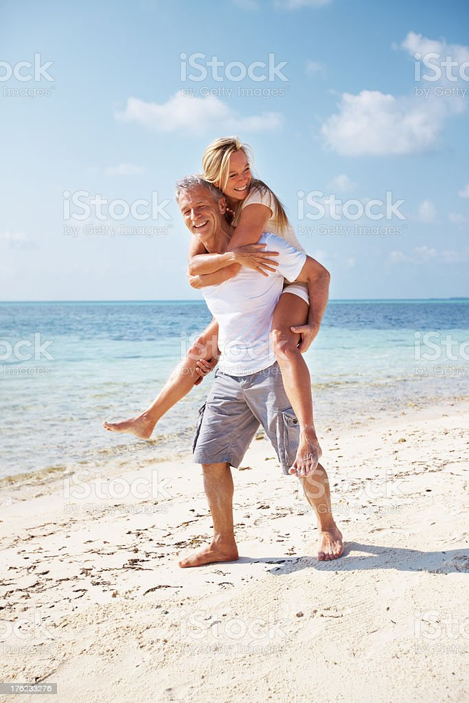 Couple playing on beach royalty-free stock photo