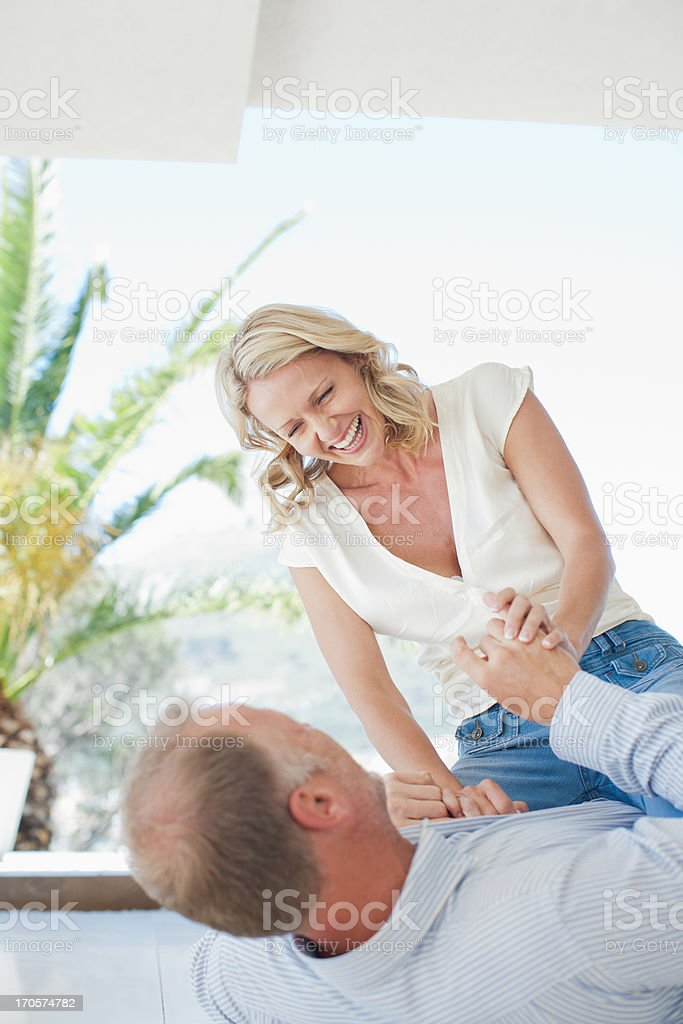 Couple playing on floor together stock photo