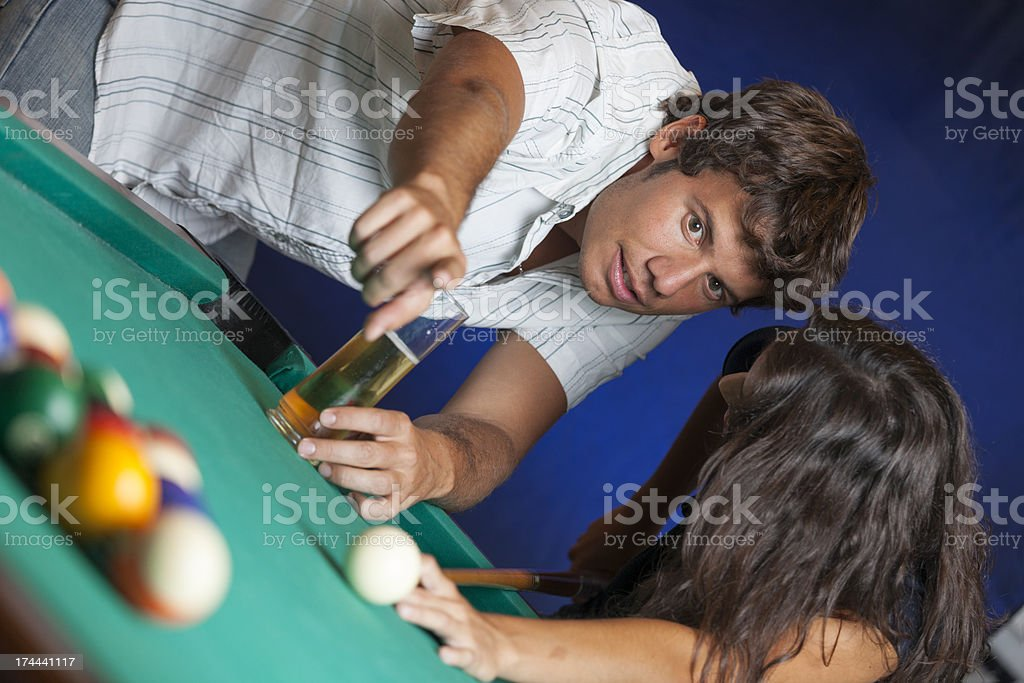 Couple playing pool royalty-free stock photo