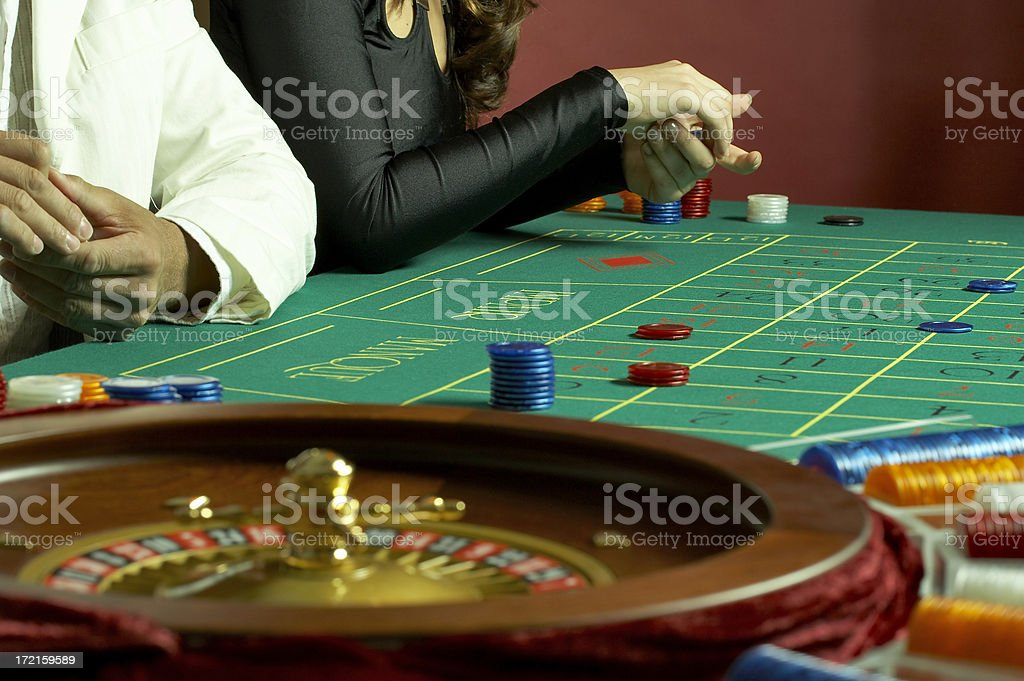 Couple playing roulette royalty-free stock photo