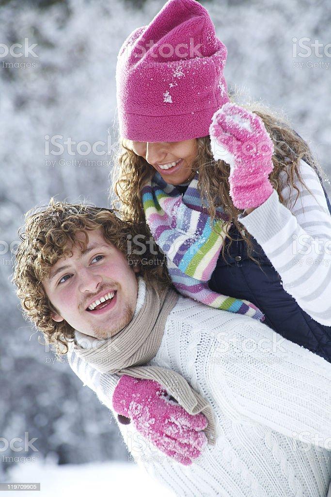 Couple playing snowballs stock photo