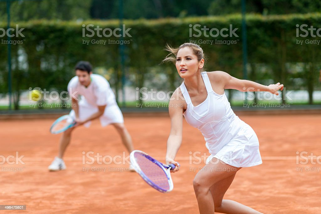 Couple playing tennis stock photo