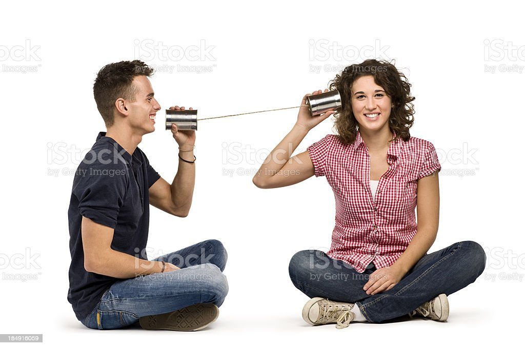 Couple Playing With A Tin Can Phone.Color Image stock photo