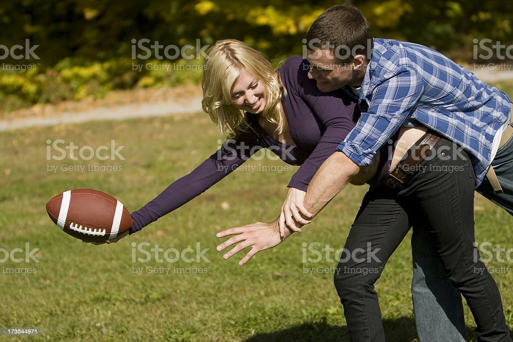 Couple Plays Football royalty-free stock photo
