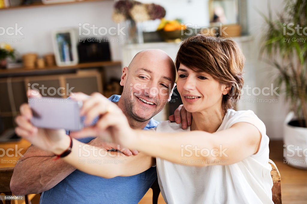 couple posing for a selfie at home stock photo