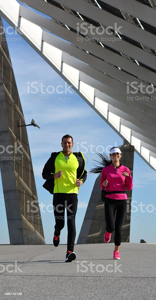 couple practicing running in the city stock photo