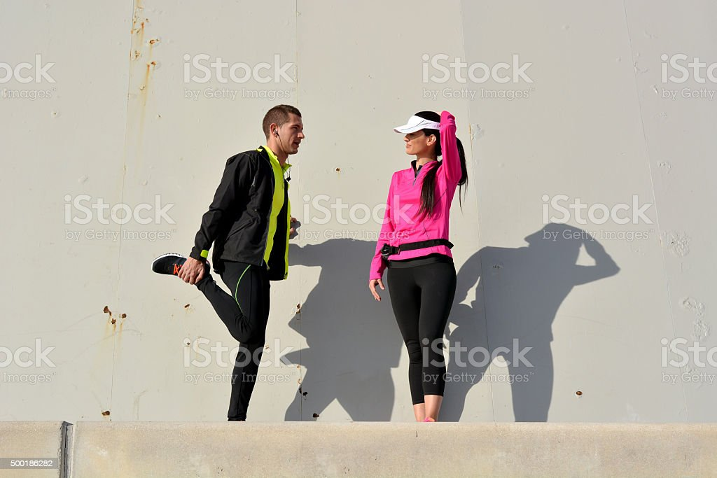 couple practicing running stock photo