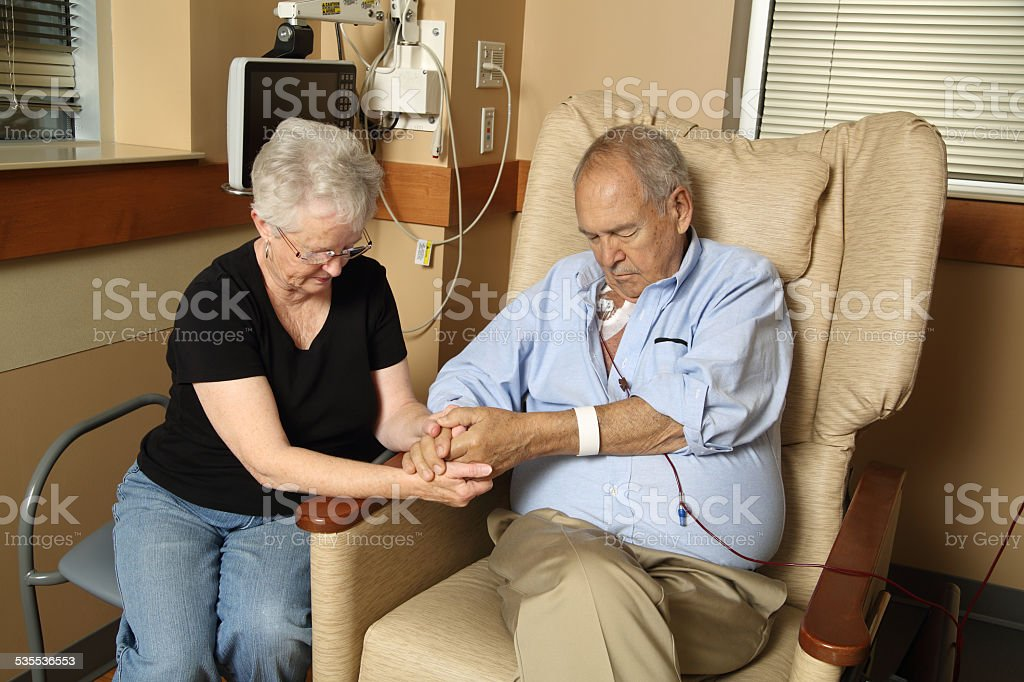 Couple Praying in Hospital stock photo