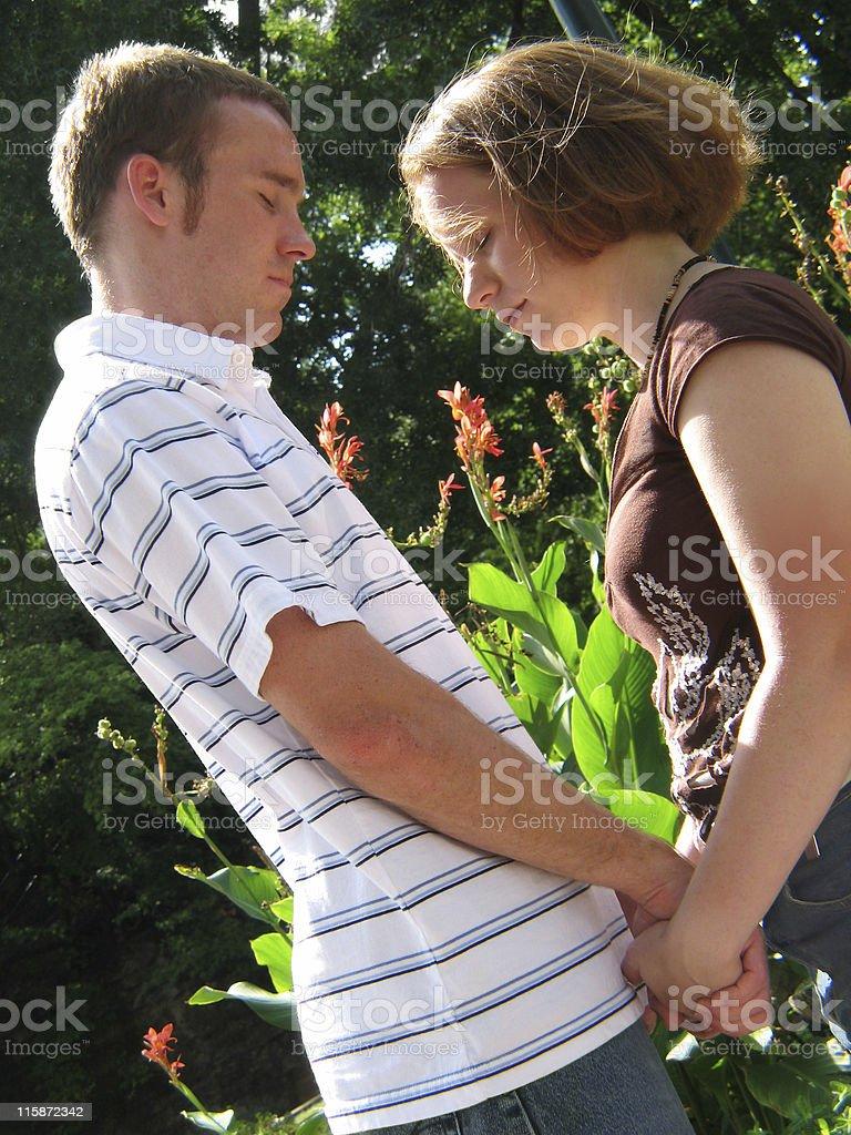 couple praying royalty-free stock photo