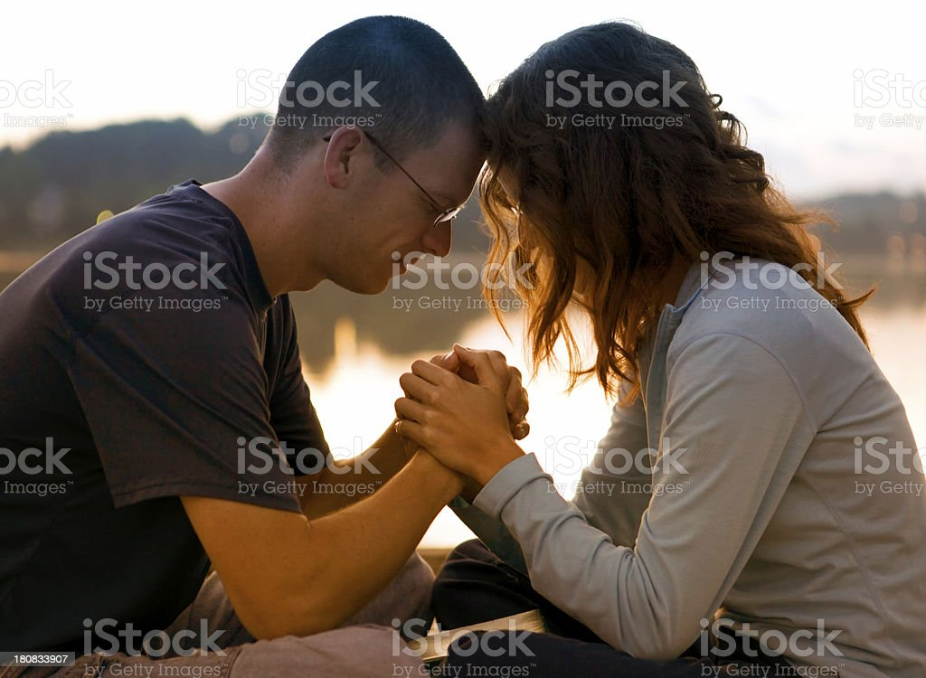 Couple Praying Together royalty-free stock photo