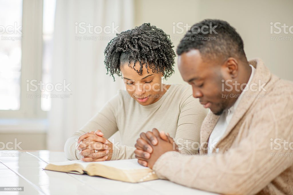Couple Praying Together stock photo