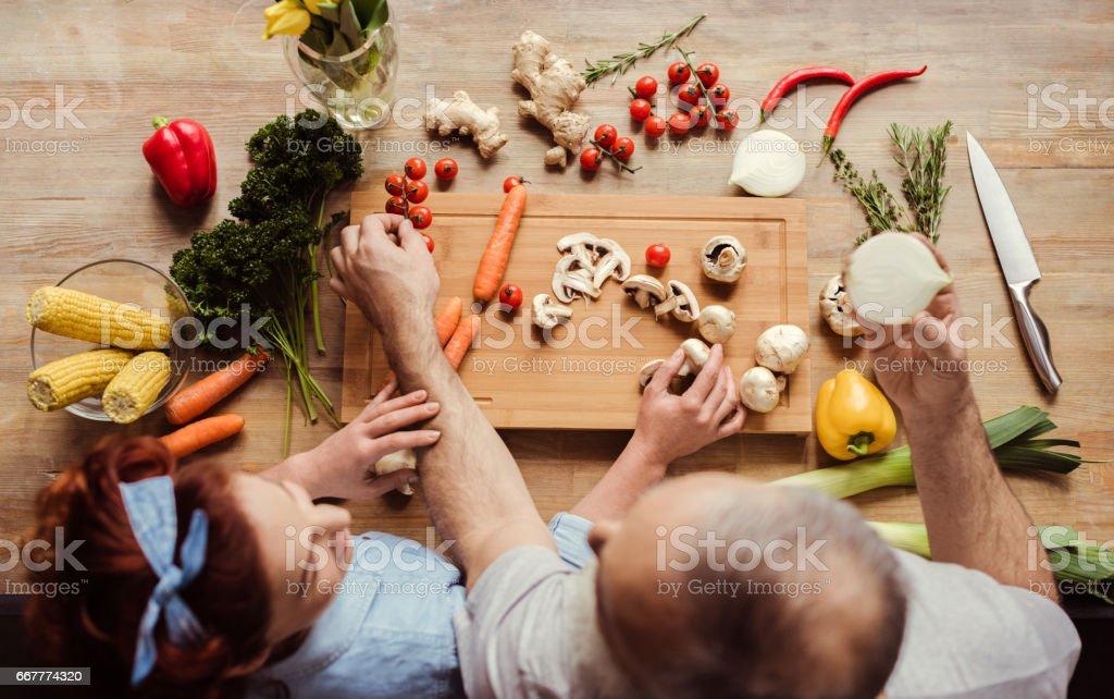 Couple preparing vegan food stock photo