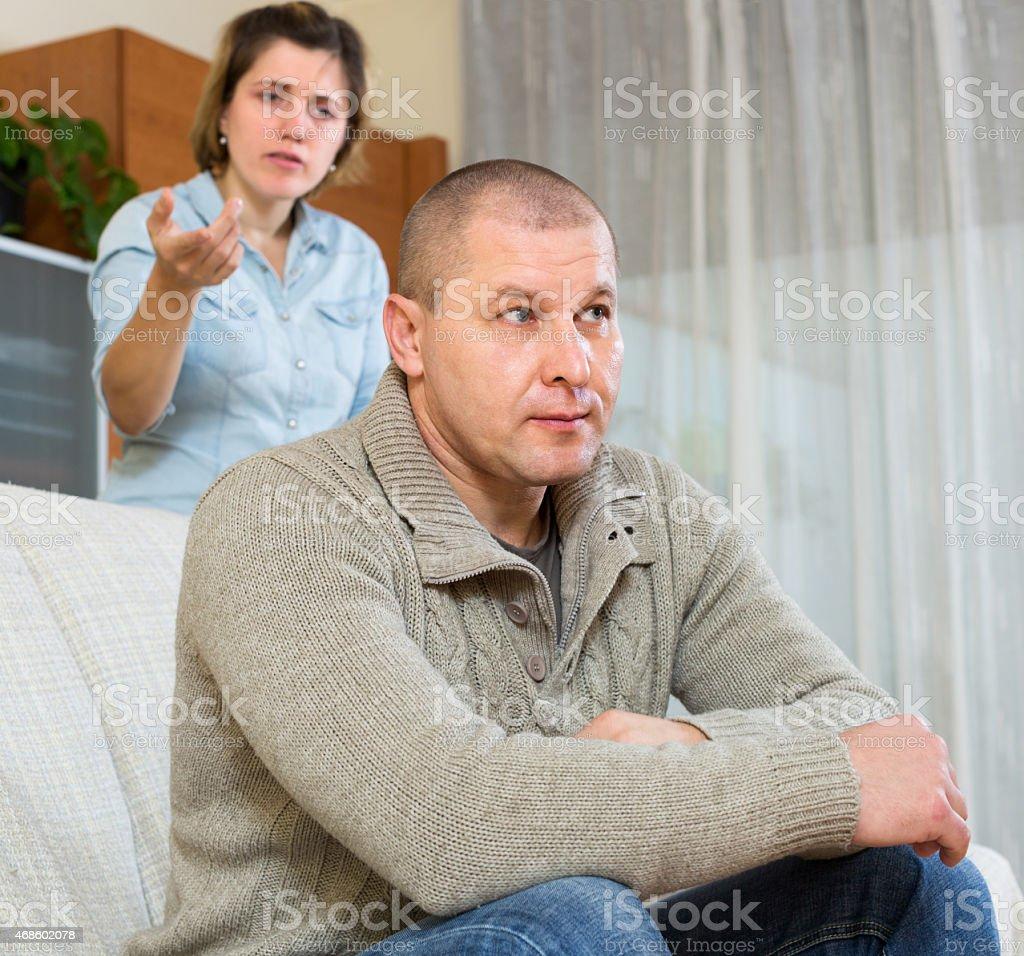 Couple quarrel at home stock photo