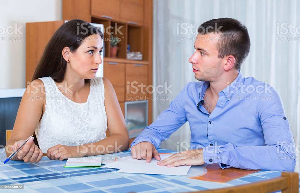 Couple quarreling at banking statement stock photo