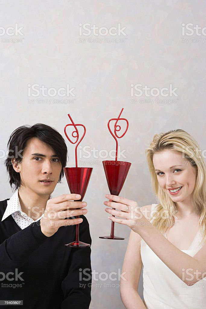 Couple raising glasses royalty-free stock photo