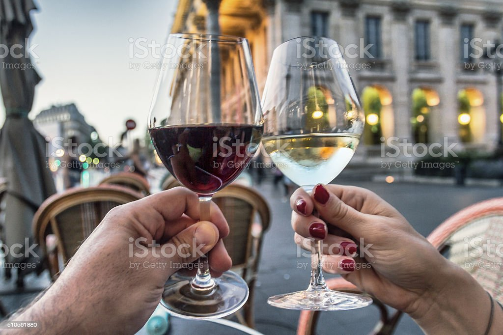 Couple raising glasses with wine stock photo