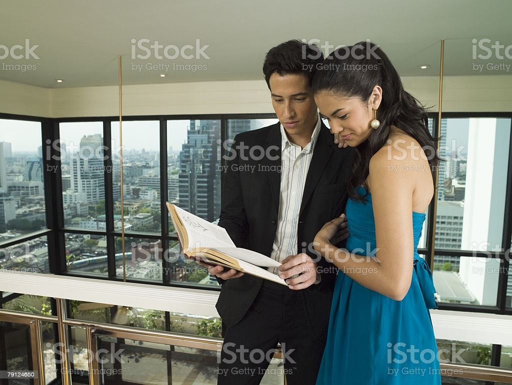 Couple reading a book stock photo