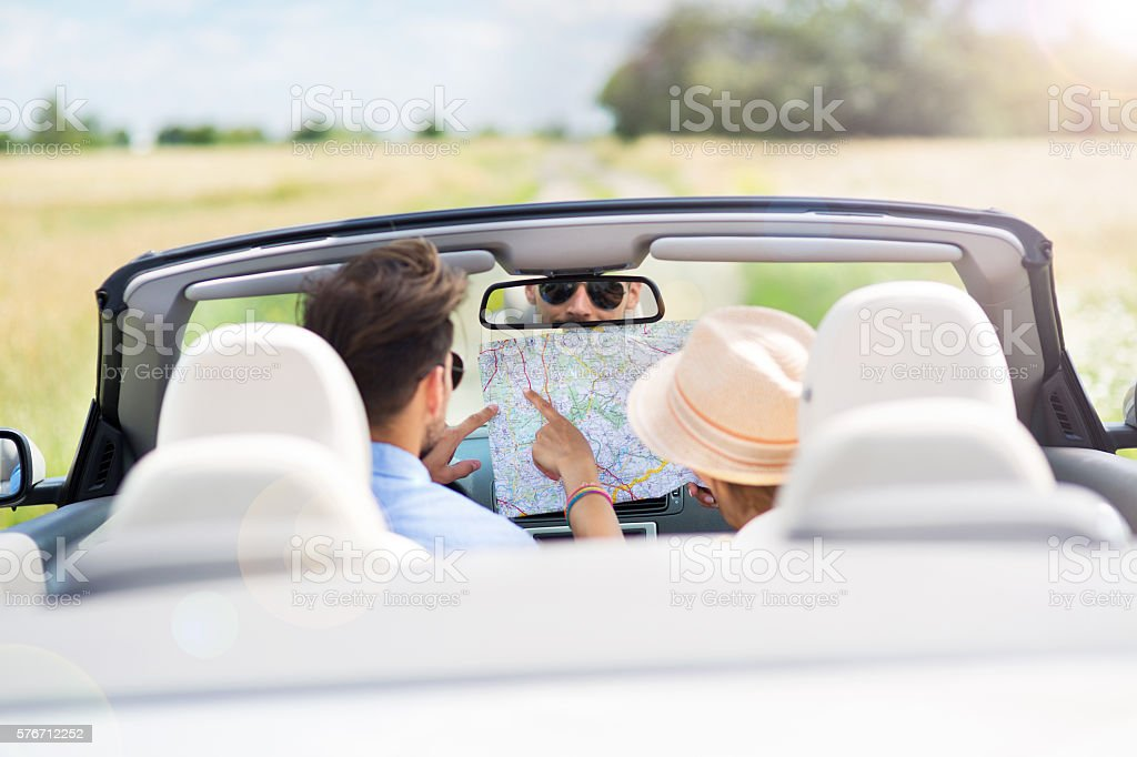Couple reading a map while sitting in the car stock photo