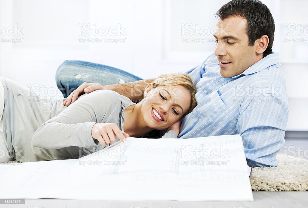 Couple reading blueprints. royalty-free stock photo