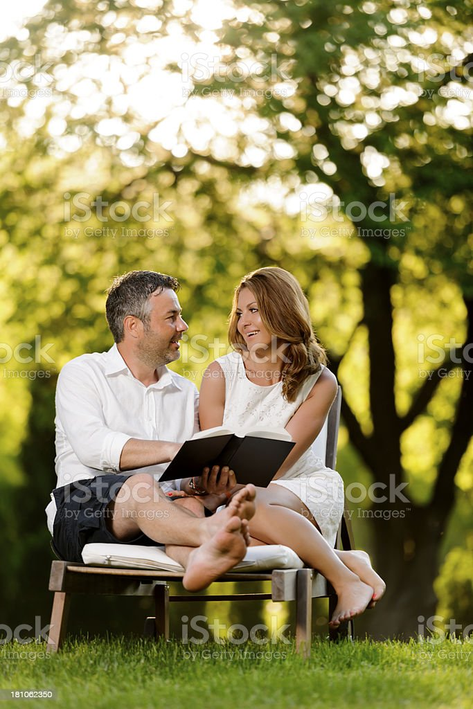 couple reading book royalty-free stock photo