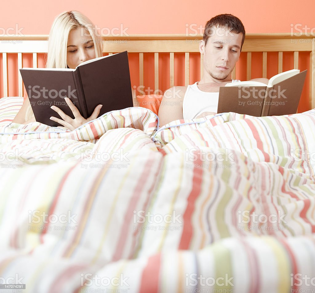 Couple Reading in Bed royalty-free stock photo