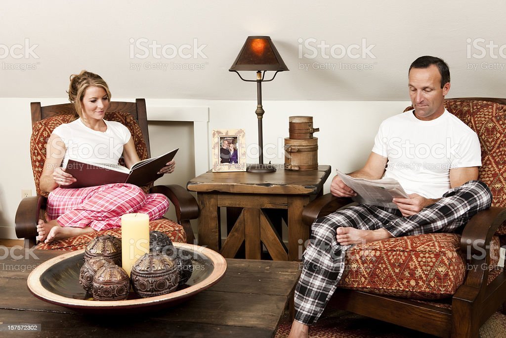 Couple Reading in Pajamas royalty-free stock photo
