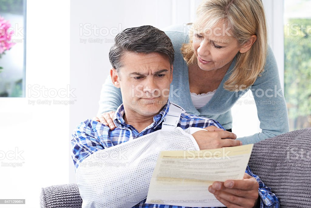 Couple Reading Letter About Husband's Injury stock photo