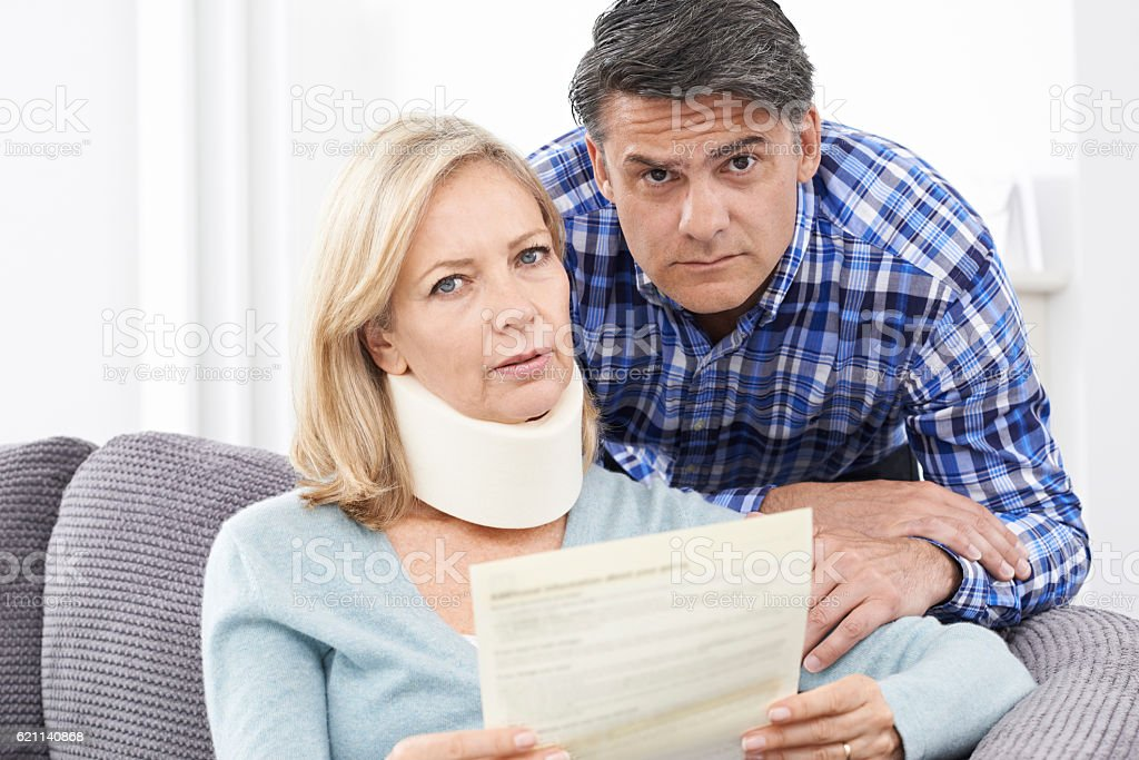 Couple Reading Letter About Woman's Injury stock photo