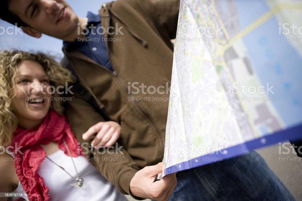 Couple reading map royalty-free stock photo
