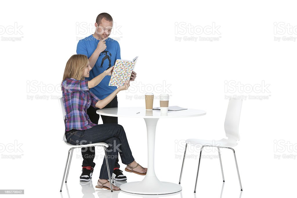 Couple reading menu in a restaurant royalty-free stock photo