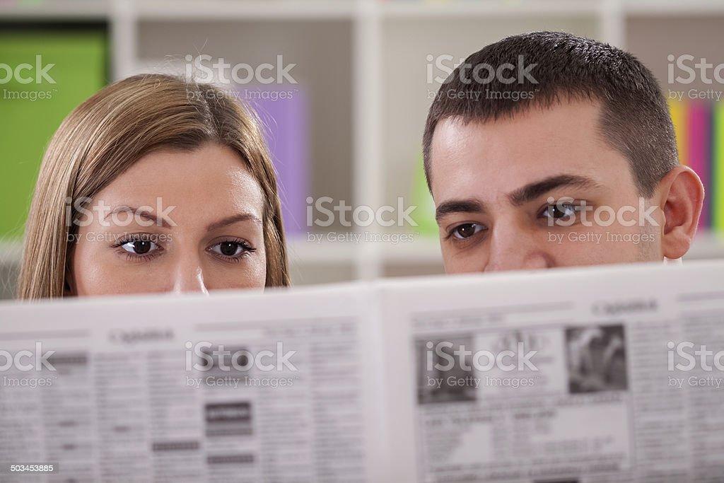 Couple reading news stock photo