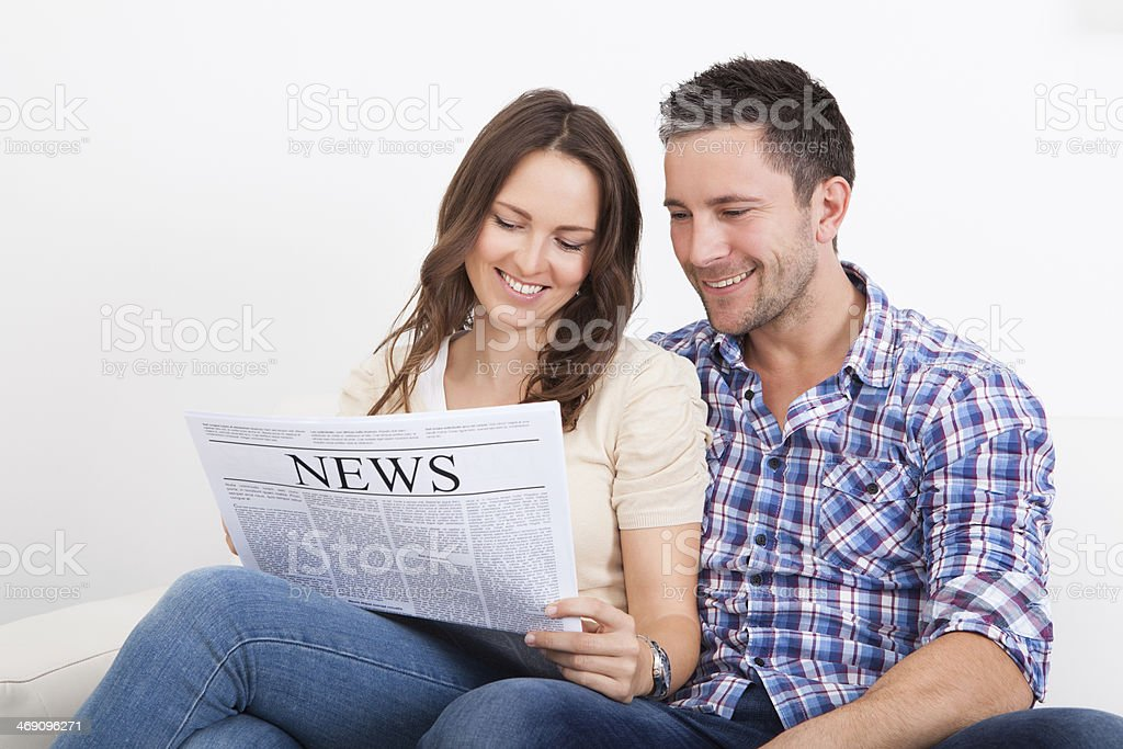 Couple Reading Newspaper royalty-free stock photo