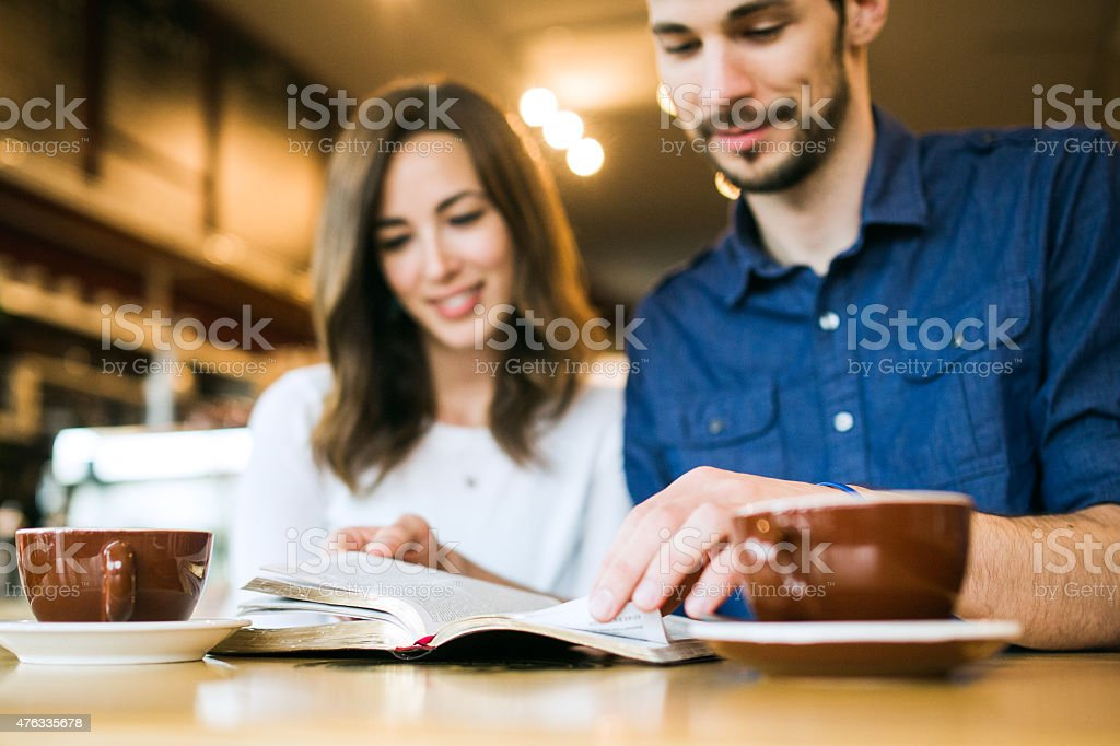 Couple Reading The Bible Together stock photo