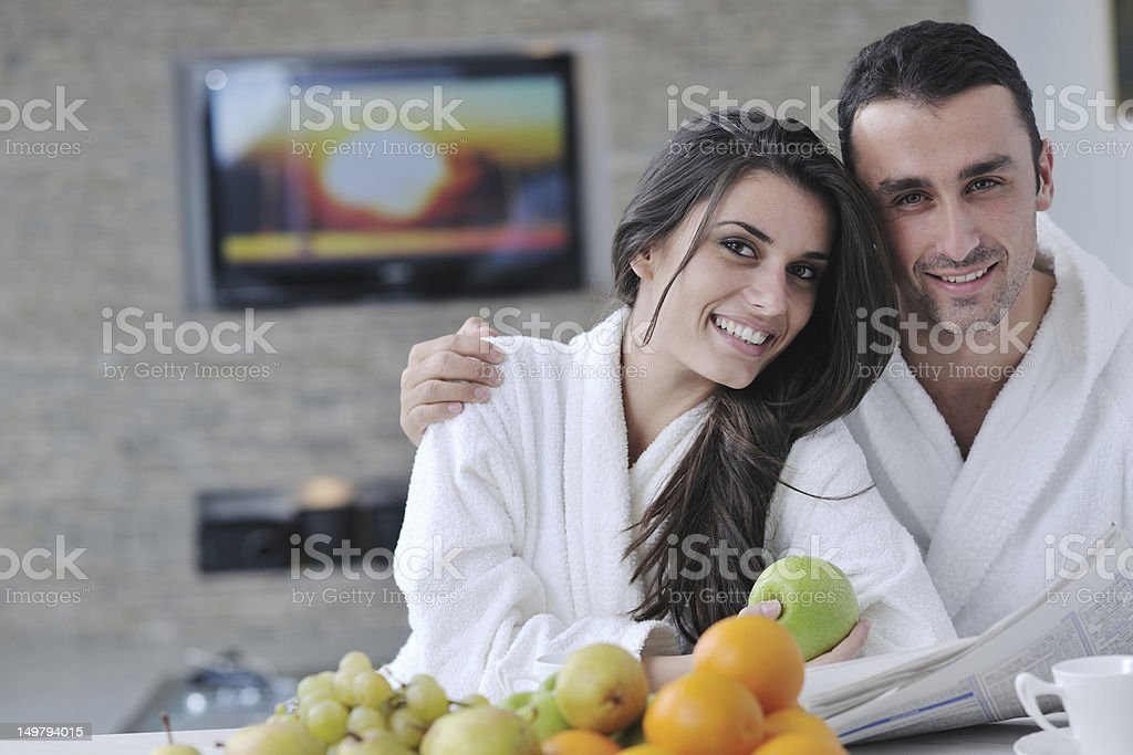 couple reading the newspaper in kitchen royalty-free stock photo