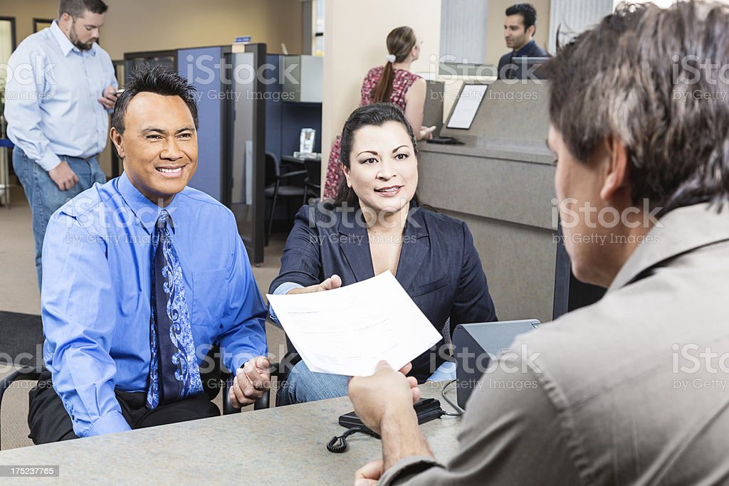 Couple Receiving Application From Banker stock photo