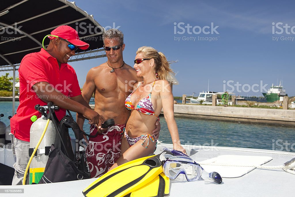 Couple receiving instruction before SCUBA Dive royalty-free stock photo