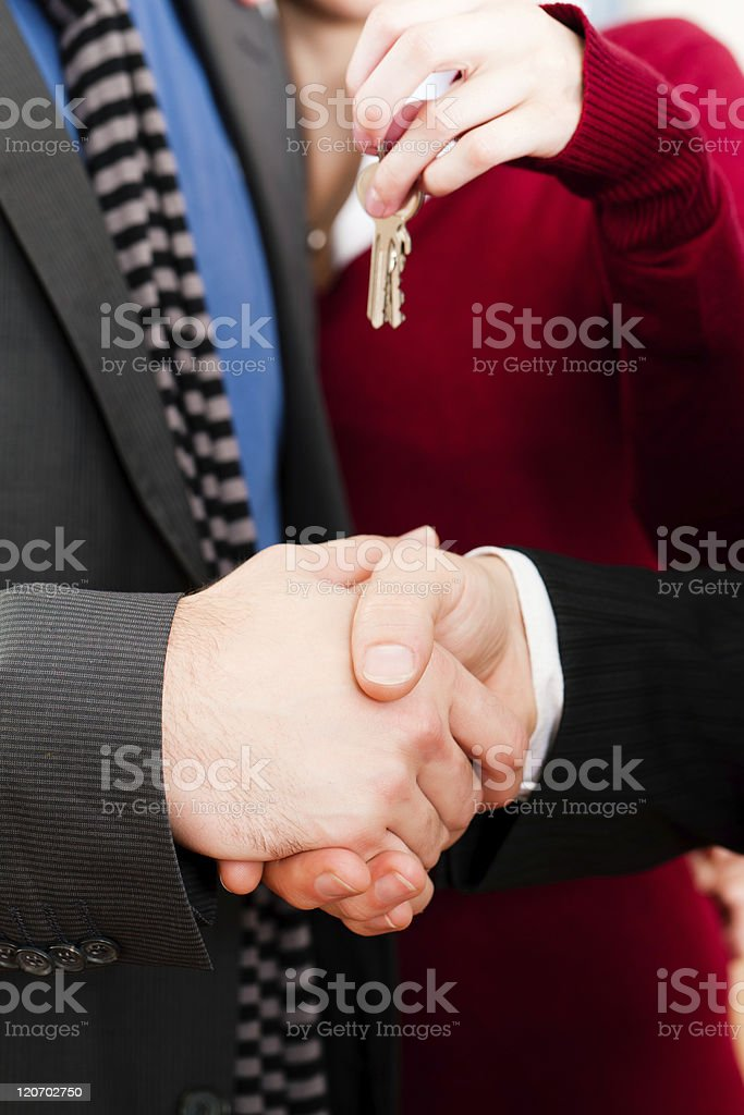 Couple receiving keys from real estate broker royalty-free stock photo
