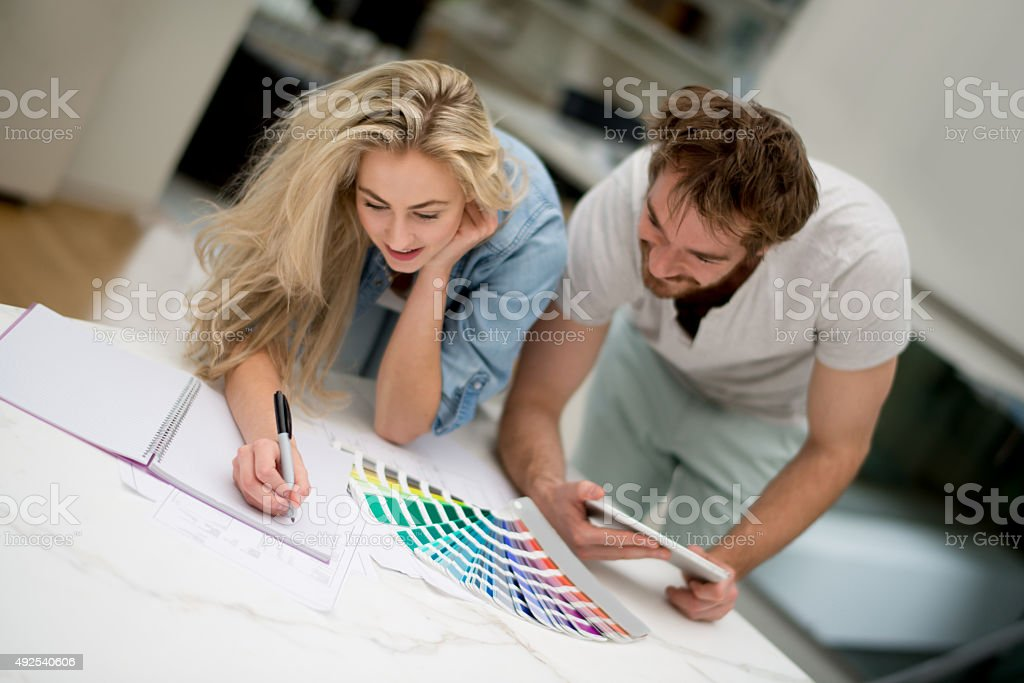 Couple redecorating their home stock photo