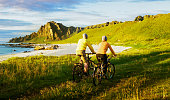 couple relax cycling in Norway