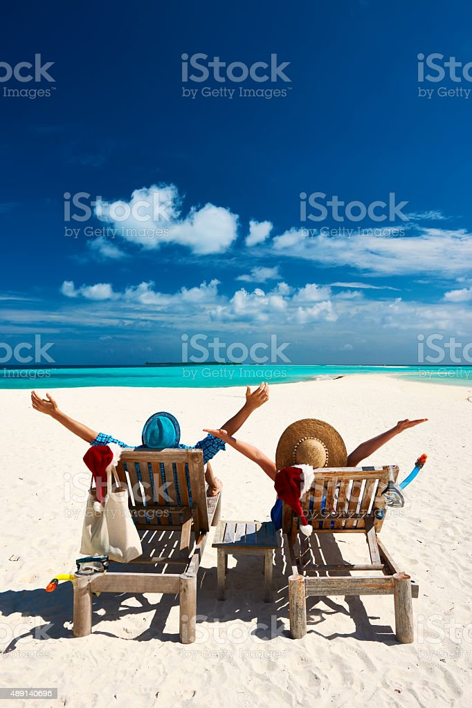 Couple relax on a beach at christmas stock photo