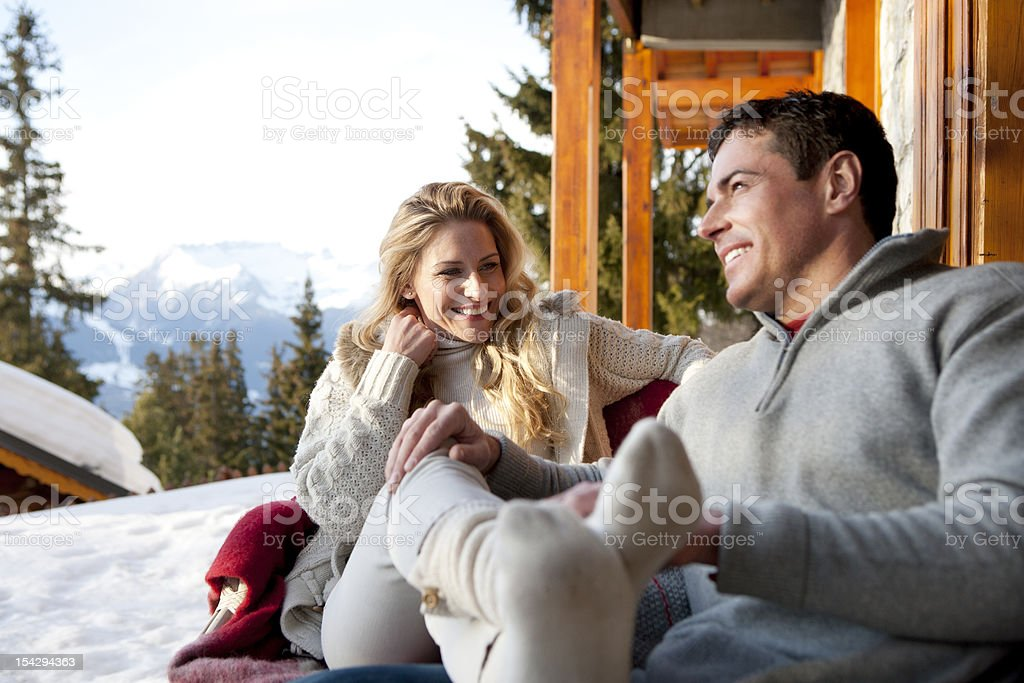 Couple relaxing After Skiing stock photo