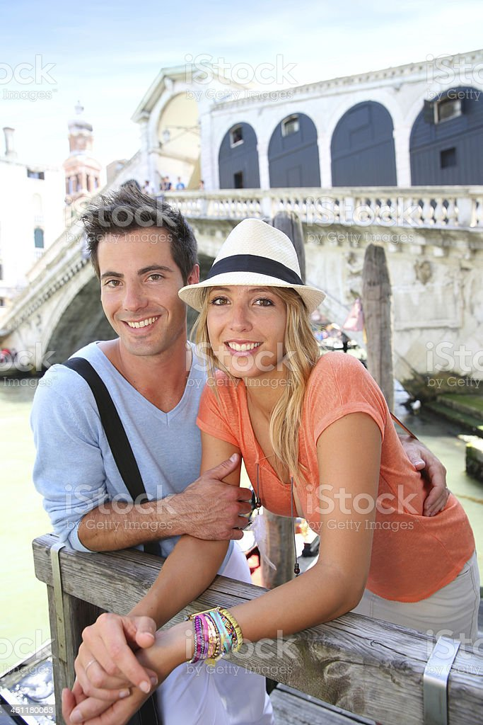Couple relaxing after visiting Rialto Bridge in Venice royalty-free stock photo