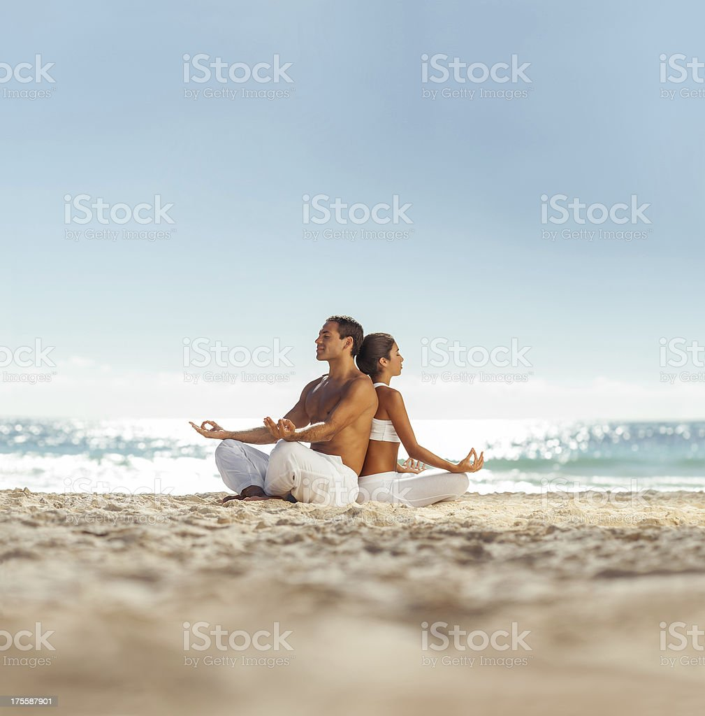 Couple relaxing and meditating royalty-free stock photo