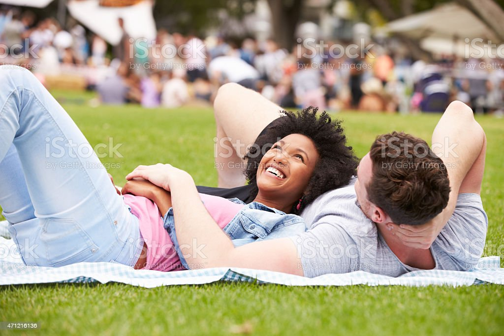 Couple Relaxing At Outdoor Summer Event stock photo