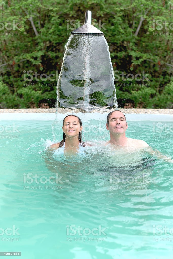 Couple relaxing at the spa stock photo