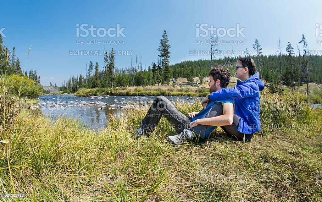 Couple relaxing by the Gardner river royalty-free stock photo